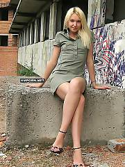 Charming and very beautiful blondie nymph taking her hot dress off at abandoned place of city.., She gets totally naked and shows long hot legs, sweet pussy, backside and pretty pink painted feet the dream of foot fetishist