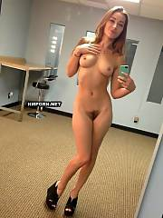 Amateur gals next-door doing naked selfies in front of the mirrors and spread legs wide to take home made xxx pictures of theur pussies close-up