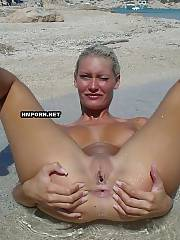 Nudist babes sunbathing nude on the beach and flashing nude butts, sweet cunts, pretty faces and sexual feet when voyeurists take far shooting pics - amateur porn pics