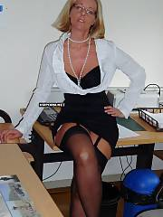 Mature secretary takes panties off and shows naked vaginal crack underskirt under the work table, making her chief incredibly horny, Then she falls in enjoy with him and gets banged hard in every hole - amateur sex pics