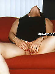 Playful sexy wife loving herself while husband watches