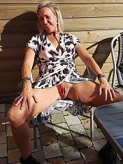 Mamma enjoys flashing her bald twat